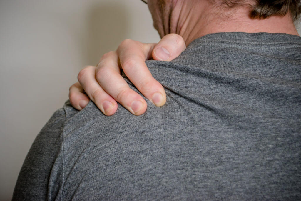 Shoulder-Surgery-Man-Gripping-Shoulder-1024x683.jpg