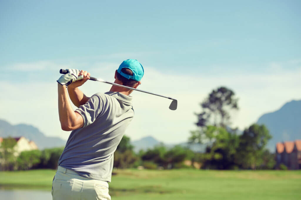 Spinal Disorder Treatment Central AZ Orthopaedic Services Male Golfer Drive